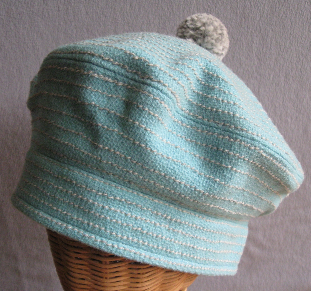 79. Wool Bouclé Tam. med/small  $75.