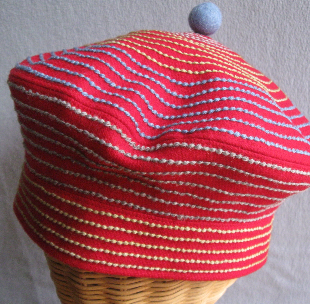 88. Red Swirl Tam. small  $75.